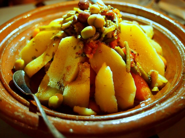 Chicken tagine with olives, potatoes, vegetables and lemon in Merzouga