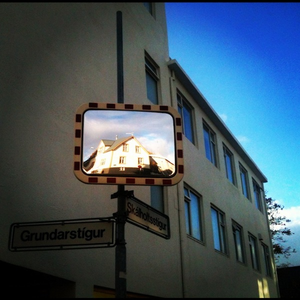 Reflected houses on a street mirror in Reykjavik